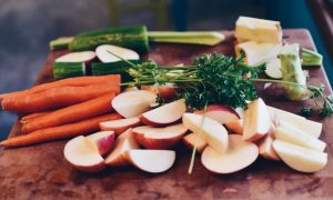 A mix of vegetables on a chopping board. Stock photo.