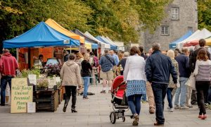 The Kilkenny Farmers Market with Kilkenny Castle as a backdrop.