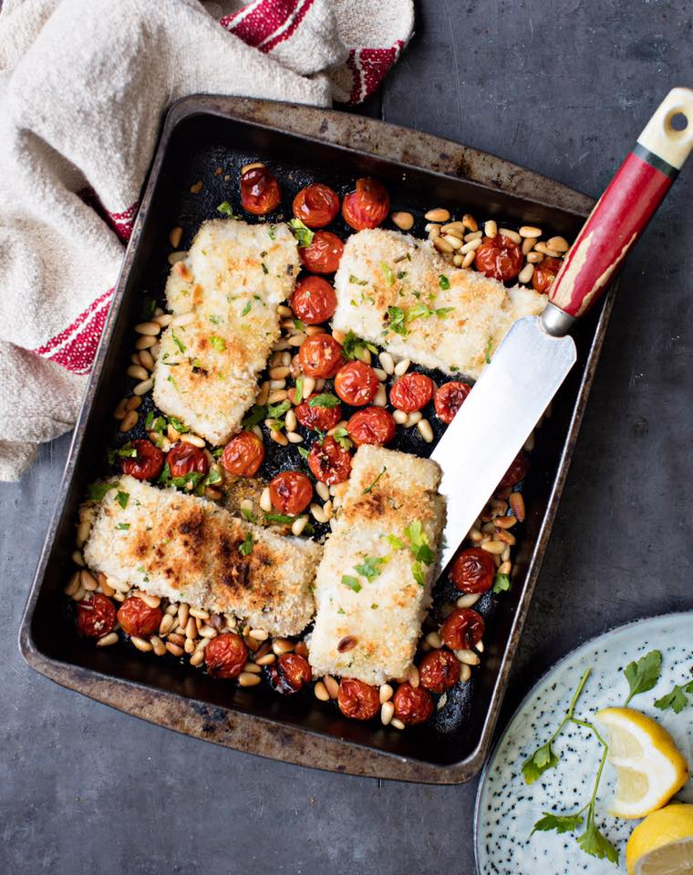 Baked trout with roast tomatos and pine nuts.