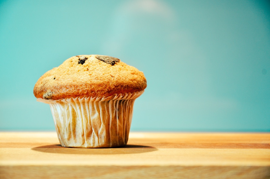 A large muffin sitting on a table top. Photo: pexels.com