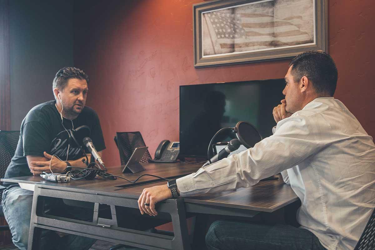 Podcast recording. Photo: NeONBRAND/Unsplash